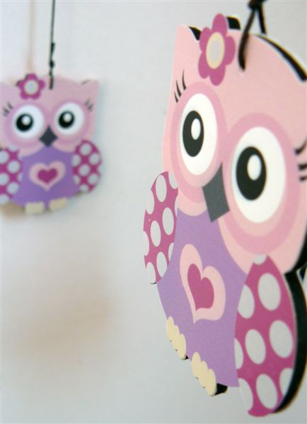 Pink owls on a cross header